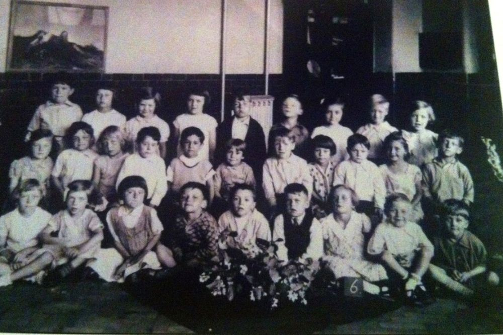 Alan Vickerman with his class in 1936 in the ground floor hall! Alan is 2nd from right in the front row.